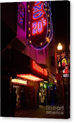 Canvas Print featuring the photograph Topless Bar Signs At Night In North Beach San Francisco by Jason Rosette
