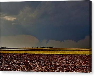 Canvas Print featuring the photograph Tornadoes Across The Fields by Ed Sweeney