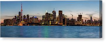 Canvas Print featuring the photograph Toronto Skyline At Dusk Panoramic by Adam Romanowicz