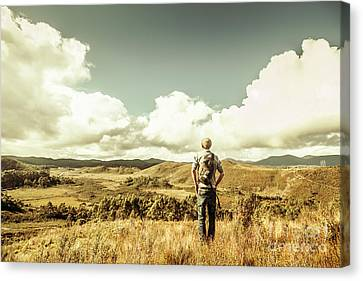 Tourist With Backpack Looking Afar On Mountains Canvas Print by Jorgo Photography - Wall Art Gallery