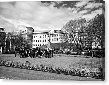 tourists on walking tour in austurvollur public square Reykjavik iceland Canvas Print by Joe Fox
