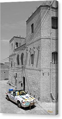 Tower And Car Canvas Print by Sascha Meyer