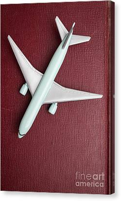 Toy Airplane Over Red Book Cover Canvas Print by Edward Fielding