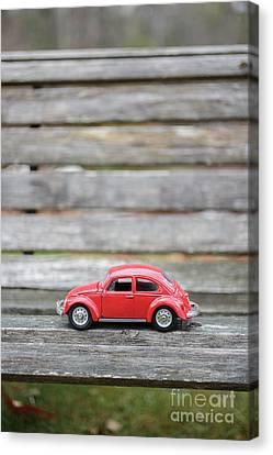 Toy Car On A Bench Canvas Print by Edward Fielding