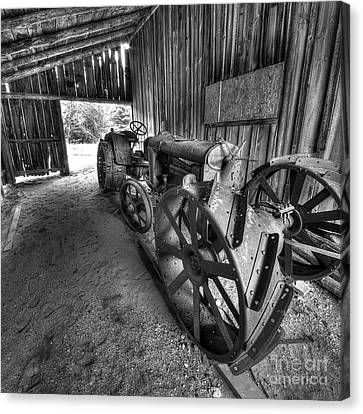 Tractor In Barn Canvas Print by Twenty Two North Photography