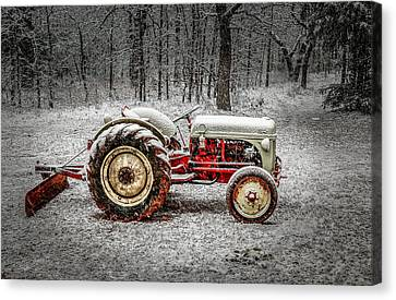 Tractor In The Snow Canvas Print by Doug Long