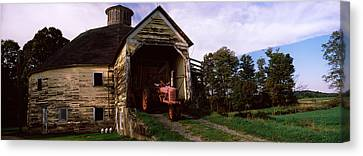 Tractor Parked Inside Of A Round Barn Canvas Print by Panoramic Images