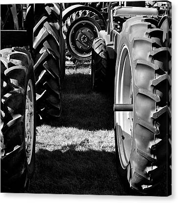 Tractor Tire Lineup Canvas Print by Luke Moore