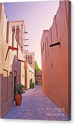 Traditional Middle Eastern Street In Dubai Canvas Print by Chris Smith
