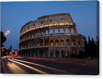 Traffic Goes By The Colosseum At Night Canvas Print by Joel Sartore