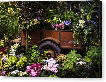 Wagon Wheels Canvas Print - Trailer Full Of Flowers by Garry Gay