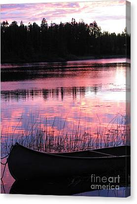 Tranquil Canoe In Sunset Canvas Print