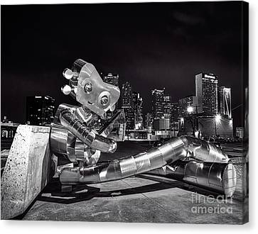 Traveling Man Sitting In Bw Canvas Print by Tod and Cynthia Grubbs