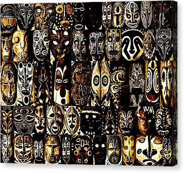 Tribal Masks Of Papua New Guinea Canvas Print by Per Lidvall