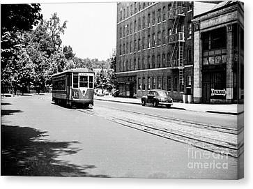 Canvas Print featuring the photograph Trolley With Packard Building  by Cole Thompson