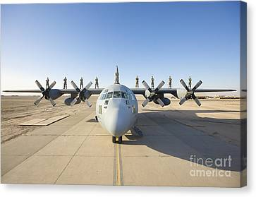 Troops Stand On The Wings Of A C-130 Canvas Print by Terry Moore
