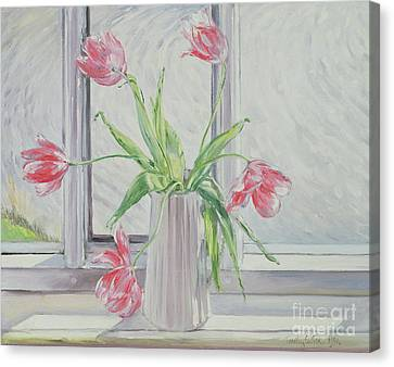 Tulips Against Moving Water Canvas Print by Timothy Easton