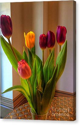 Tulips On Table Canvas Print by Joan-Violet Stretch