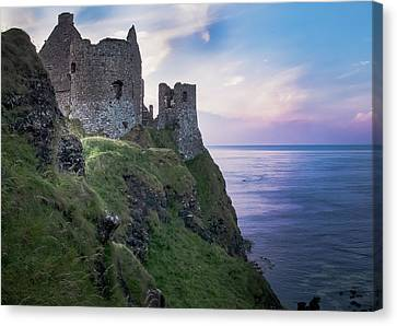 Twilight At Dunluce Castle Canvas Print by Alan Campbell