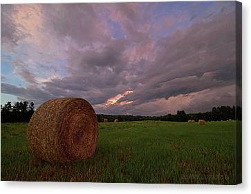Twilight Hay Bale Canvas Print by Jerry LoFaro