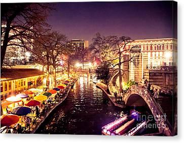 Twilight In The Riverwalk Canvas Print by Iris Greenwell