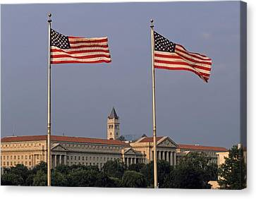 Two American Flags With Old Post Office Building Canvas Print by Sami Sarkis
