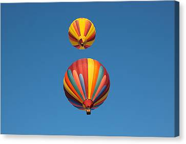 Two Balloons Passing Over Canvas Print
