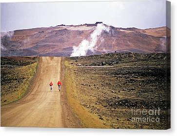 Two Bikers On A Dirt Road Leading To A Geothermal Power Station At Myvatn Canvas Print by Sami Sarkis