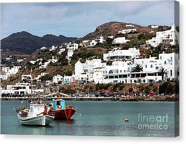 Two Boats In The Mykonos Harbor Canvas Print by John Rizzuto