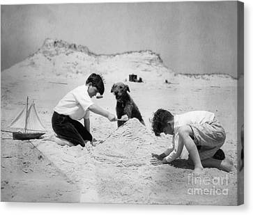 Two Boys And Dog Playing On Beach Canvas Print by H. Armstrong Roberts/ClassicStock