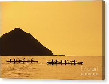 Two Canoes Silhouetted Canvas Print by Dana Edmunds - Printscapes