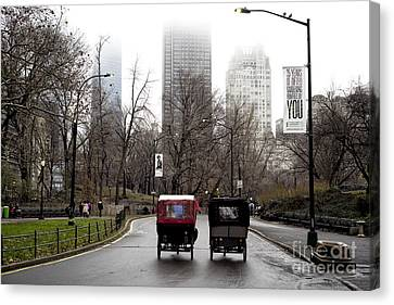 Two Carriages Canvas Print by John Rizzuto