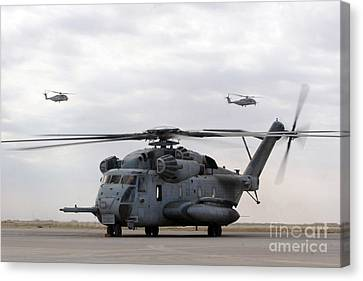 Iraq Canvas Print - Two Ch-53e Super Stallion Helicopters by Stocktrek Images