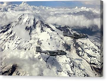 Two Ea-6b Prowlers Fly In Formation Canvas Print by Stocktrek Images