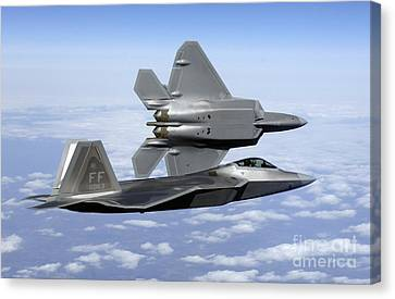 Two F-22a Raptors In Flight Canvas Print by Stocktrek Images