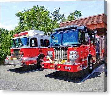 Two Fire Engines In Front Of Firehouse Canvas Print by Susan Savad