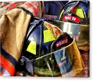Truck Canvas Print - Two Fire Helmets And Fireman's Jacket by Susan Savad