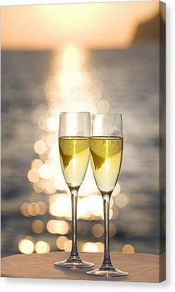 Two Glasses Of Champagne At Sunset Canvas Print by Bill Holden