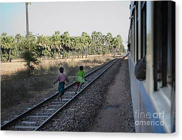 Two Kids Run Along And Follow Train In Burma Canvas Print