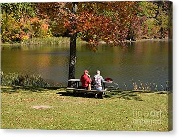 Two Men At The Lake Canvas Print by Andrea Simon