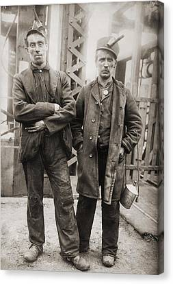 Two Miners Leaving Entrance Of Coal Canvas Print by Everett