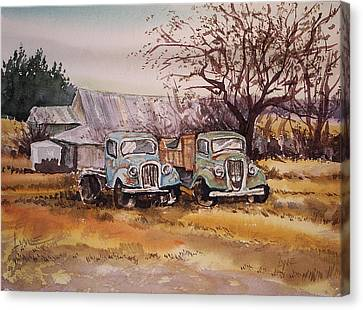 Two Old Trucks Canvas Print