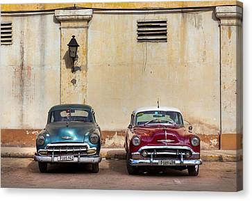 Canvas Print featuring the photograph Two Old Vintage Chevys Havana Cuba by Charles Harden