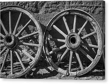 Wooden Wagons Canvas Print - Two Old Wagon Wheels by Garry Gay