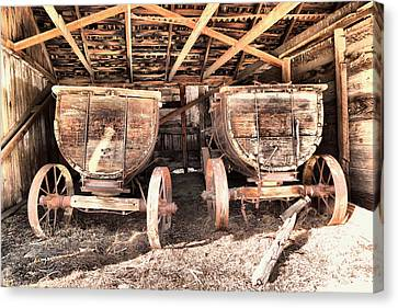 Canvas Print featuring the photograph Two Old Wagons by Jeff Swan