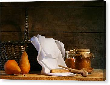 Two Pears With White Cloth Canvas Print by Sandra Cunningham