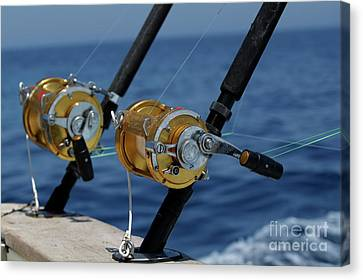 Two Rod And Reels On Board A Game Fishing Boat In The Mediterranean Sea Canvas Print by Sami Sarkis