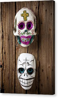 Two Skull Masks Canvas Print by Garry Gay