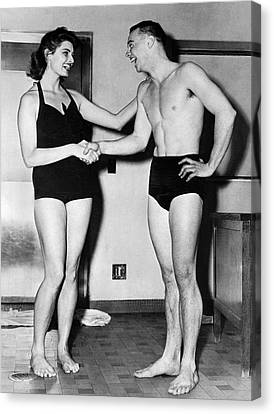 Gloria Canvas Print - Two Swimming Stars by Underwood Archives