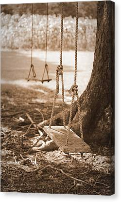 Two Swings - Sepia Canvas Print by Beth Vincent